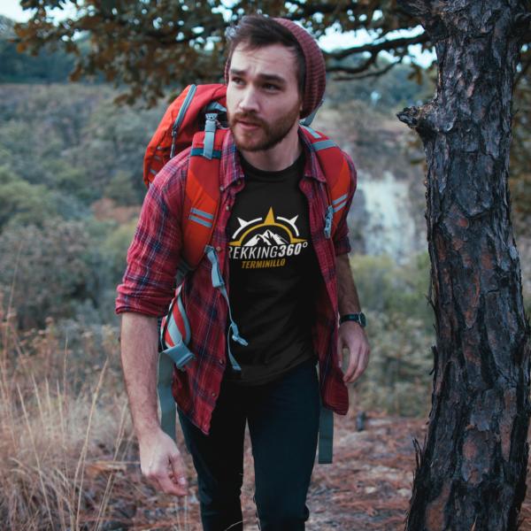 man-wearing-a-tshirt-mockup-trekking-at-the-mountains-a19036